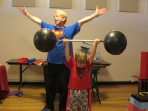 strong kid lifting dumbbells